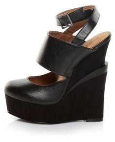 I need more shoes that make me over 6' tall. Need, I said. Need. Michael Antonio Studio Galang Black Triple Platform Wedges. $89