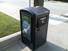 The innovative bin consists of a solar PV module which powers a 12v battery, which in turn provides the power for the internal compactor.  The BigBelly takes up roughly the same footprint of an existing street bin but, because of the compactor, can hold eight times more waste than the average bin. The solar-powered compactor exerts 1,200 pounds of force and runs on less than 5Wh per day provided entirely by the sun's energy.