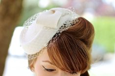 veil doesnt have to cover face, just decorative around the hat... 40s/50s style felt pillbox hat with bow and veil in ivory