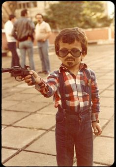 Robert Downey Jr as a child? Or Zach Galifianakis growing his beard out for the winter.