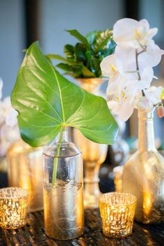 Green, Gold, White & Black. Perfect for a chic and glamorous wedding. Orchids looked so beautiful coming out of the tall golf flaked floral container.
