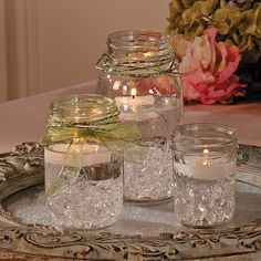 Mason Jar Centerpiece - OrientalTrading.com  using blue water beads, shell charms, blue floating candles?