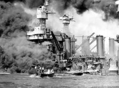 A small boat rescues seaman from USS West Virginia burning in foreground. Smoke rolling amidships shows where most extensive damage occurred after Japanese attack on Pearl Harbor. USS Tennessee in inboard. Dec. 7, 1942