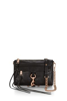 Mini M.A.C. Crossbody - A petite take on Rebecca's classic M.A.C. clutch, this handbag is much roomier than it looks. It's big enough to fit your phone, keys, wallet and makeup essentials, but sleek enough so that it won't weigh you down. Wear it on your shoulder or crossbody with the adjustable chain strap.Style #: HF14RFCX01Not Eligible For Promotion
