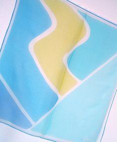 blue + turquoise ocean waves around a strip of sandy beach [Vera Neumann scarf]