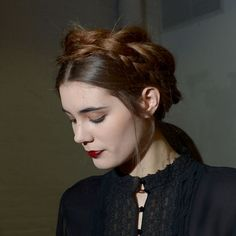 Alicia + Olivia hair - Messy milkmaid braid: They braided the models' real hair and wrapped it around the back of their heads, then took a fistful of clip in extensions, braided them, cut the glue strip at the ends off and pinned it to the braid of real hair.
