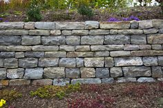 These beautiful walls and features are built stone by stone, with no mortar used to cement the stones together. While the concept sounds intimidating to some, our specialized teams are well-versed in dry stone construction. Aesthetic Look, Dry Stone, Landscape Services, Retaining Walls, Concrete Blocks, Exterior, Outdoor Decor, Nature, Cinder Blocks