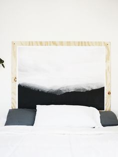 you have art all over your walls, why not add some to your headboard?    DIY Plywood Print Headboard