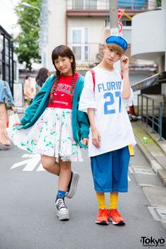 P-Chan and Karin are well known in Tokyo – and around the world – as two of the dancers in the Japanese dance group Tempura Kidz. When we met them on the street in Harajuku this time, they wore wearing colorful, sporty outfits. Karin, with twin braids on the left, is wearing a remake Chicago Bulls floral t-shirt dress, a teal jacket from Champion, blue socks and platform sneakers from Jouetie. She loves shopping for clothes at used/resale shops and likes to listen to Judy and Mary. Karin is…