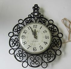 Vintage General Electric Wall Clock Model #2151 Black Wrought Iron Style Plastic Please Repinit and Thanks so MUCH.