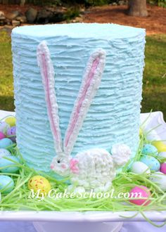 Love this take on an Easter ruffle mile high cake. Pretty pastels. Easter eggs. And a bunny rabbit. Blog tutorial.