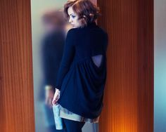 Love the peekaboo hole in the back of the sweater.  The sweater looks amazing styled this way.