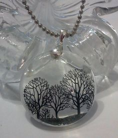 This is a very highly requested Tutorial on how to make my Transparent Tree of Life Pendant. It's a very simple and easy technique. Once you learn this techn...