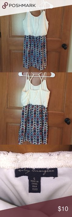 Size small cute summer dress Size small cute summer dress that gathers at the waist with an adorable strappy back. Cream lacy top with elastic waist and double layered bottom. Fun pattern, only worn a few times! Sorry no trades downsizing for college!☺️ Charlotte Russe Dresses Mini
