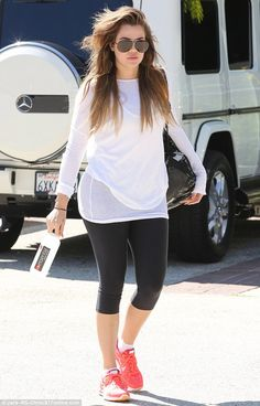 Great excuse: Khloe can be forgiven for looking a little wild, as while most people slept in on Sunday, she had already hit the gym for a gruelling workout