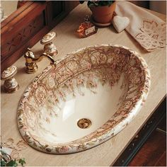 Kohler Tale of Briar Rose Design Bathroom Sink.  Gorgeous!