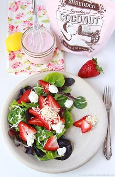 Strawberry, Coconut, Chevre Spinach Salad with Strawberry Dressing on www.cookingwithruthie.com is a favorite during the spring and summer months!