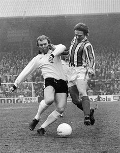 Fulham defender Bobby Moore challenges Sheffield United forward Keith Edwards during a game at Craven Cottage in 1977.