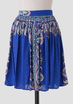 Perfect for pairing with your favorite neutral blouses, this deep blue skirt is adorned with a global-inspired print.
