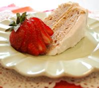 This strawberry cake is light and moist. A pretty pink cream cheese frosting gives it an extra sweet touch. Garnish each piece with some sliced strawberries.