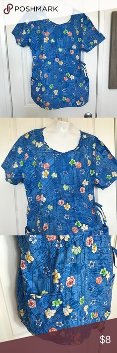 Blue Floral Scrub top size XL Blue Floral Scrub top Cherokee brand Side ties and two front deep pockets.    size XL Pit to pit measures approximately 22 in and 29 in long 100% cotton Cherokee Tops