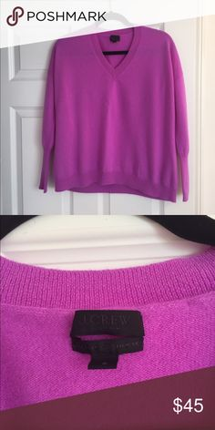 J. Crew Italian Cashmere Boyfriend Sweater This cashmere sweater is super soft and the color (neon amethyst) is beautiful! I hate to part with it but I already own too many colorful cashmere sweaters. I wore this once and then had it dry cleaned. Like new condition. J. Crew Sweaters V-Necks