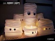 Too CUTE! Wrap old plastic containers in gauze and attach google eyes.. lil mummy's.