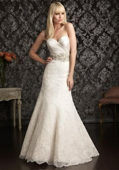 Elegant and sophisticated. This slim gown combines lace and satin beautifully. The natural waist bodice features a sweetheart neckline and asymmetrical ruching. Swarovski crystals and beading create a sparkling belt detail while lace finishes the gown throughout the skirt.