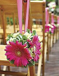 aisle flowers - hanging (don't love the flowers but like the simple ribbon tie)