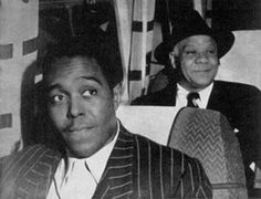 Charlie Parker and Sidney Bechet en route to the Paris jazz festival in 1949.