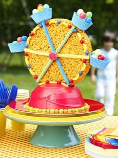 Ferris Wheel Cake.  Uses a Round Krispy Treat Wheel and  Cupcake Candy Baskets.