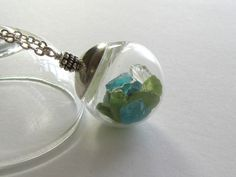 March Birthstone Keepsake Necklace : Aquamarine Necklace with Peridot and Citrine, Blue Green Gemstone Nuggets in Glass Globe, Birthday Gift. $90.00, via Etsy.