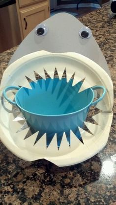 Made these from paper plates and gray construction paper for shark party. Fill with gummy worms and eat at your own risk!