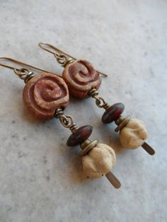 Gorgeous ceramic clay spiral beads, expertly handcrafted by Barbara Hanselman, team up with Barbaras small ceramic lantern beads and matte Czech