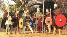 """Members of Regia Anglorum in 1996 as pagan Saxon and British warriors at Sutton Hoo for a BBC production about the Sutton Hoo excavation in 1939."""