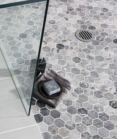 We are keen on hexagonal mosaic tiles for the shower floor and walls. Or just walls or just floor. Shower Floor Tile, Bathroom Floor Tiles, Laundry In Bathroom, Laundry Rooms, Grey Tile Shower, Toilet Tiles, Bathroom Bin, Shower Niche, Shower Pan