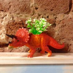 A personal favourite from my Etsy shop https://www.etsy.com/uk/listing/253593297/dinosaur-tricerapots-fun-retro-plant-pot