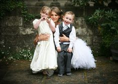 Flower girl and ring bearer with bride. Must have :)