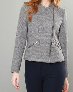 A modern cropped biker style jacket with full-length sleeves, zipped cuffs and slant zip pockets. The fabric was designed and woven in our mill in Donegal, Ireland with the base colour being a luxurious stone and navy geometric Donegal tweed and featuring flecks of pink and yellow throughout. The lining is a Liberty of London print.