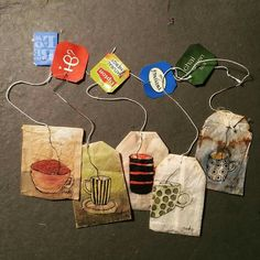Draw On Used Tea Bags... Just dry them out throw away the tea leaves. I've done this!! It's fun... and gets people buying because its different.