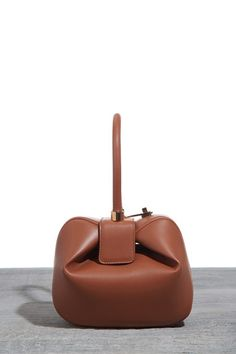 59a2bac96530 We're dubbing Gabriela Hearst's Nina bag a cult classic. See why it's so  popular among the fashion set.