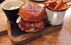 Greedy pig burger with sweet potato fries & homemade slaw.