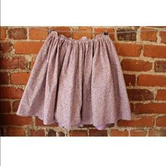 """EUC J. Crew CrewCuts Kids Sz 12 Floral skirt women Brand:J. Crew """"Crew Cuts"""" Style: skirt Size Type:Regular Size: Kids size 12 (but could be worn by an adult-view dimensions below) Color:lavender yellow Multi-Colored Pattern:Floral Material: 100 % cotton Occasion:Casual, Career, Fun, Party Lined: Yes (lining is 80% polyester, 20% Cotton) Pockets:No Zipper:No Sheer:No Buttons:No Embellishments: No Measurements: Waist:24 inches slightly stretches to approx. 26 inches Bottom…"""