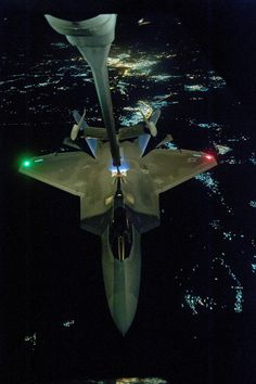 The U.S. Air Force has released images of its latest fighter jet on one of its first combat missions. An F-22 Raptor stealth jet - above - is seen being refu...