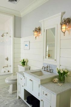 Suzie: Jillian Klaff Homes - Cottage bathroom with gray paint color, tongue and groove walls, ....
