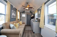 The Laurel is a tiny home from Virginia-based Tiny House Building Company. The home has a king size loft and living room with separate workspace. Tiny House Big Living, Tiny House Blog, Tiny House Trailer, Tiny House Plans, Small Space Living, Living Spaces, Tiny Houses For Sale, Little Houses, Beautiful Small Homes