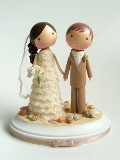 These make me want cake toppers! Rob should be a bit taller, darker hair...