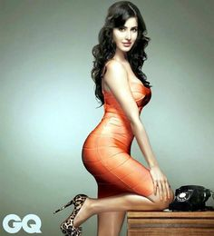 Solid Orange Dress worn by Katrina Kaif for GQ magazine cover shot paired with gorgeous leopard print pumps !