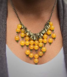 Bib necklace with yellow jade gemstones and antique brass leaf chain by TheJulieLynBoutique on Etsy -- a unique necklace with a boho chic style