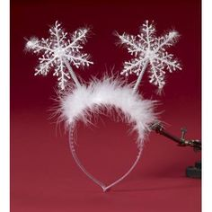 Shimmer Santa's Snowflake Christmas Headband - Have snow for Christmas this year when you wear this snowflake headband! The headband itself is clear with sparkles and attached white feathers. The two snowflakes are plastic with shimmery tinsel threaded around them. Have a great time wearing this Snowflake headband to your Christmas party, around the workplace or general fun!  #snowflake #christmas #headband #yyc #costume